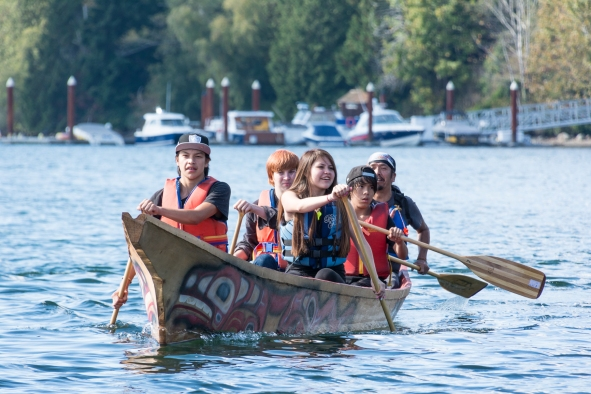 Four Streetfront students become the first youth to paddle this canoe.