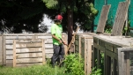 Cody works on the compost bins.