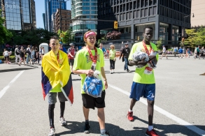 Successful, fast runners Ibin, Eero and Abiel walk to the group meeting area.