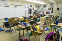 The breakfasts of champions clutter the classroom after the sleepover.