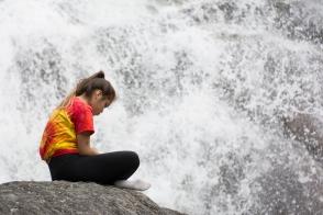 Quiet contemplation beside a noisy falls